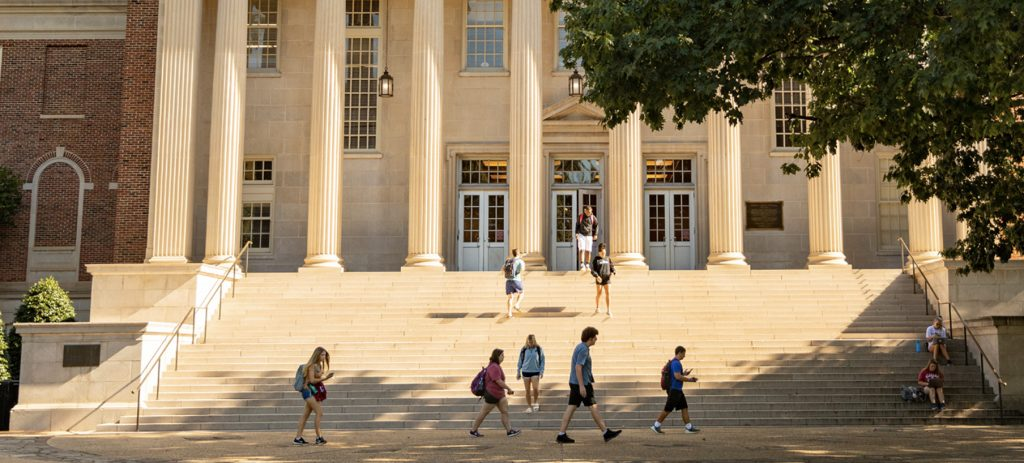 Students pass in front of Gorgas Library
