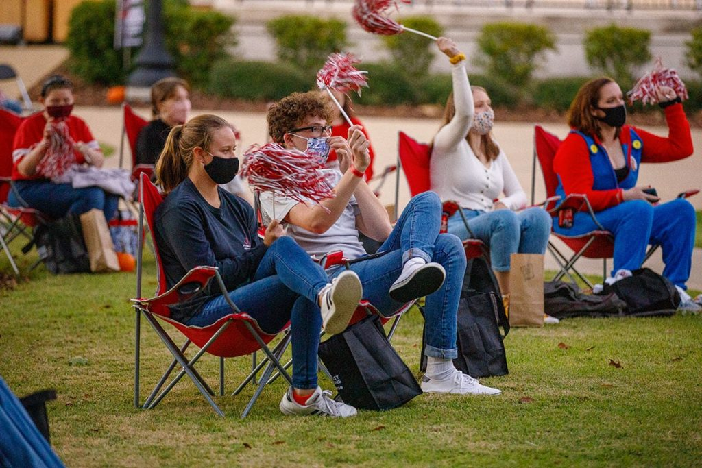 Socially distanced Bama fans watch a game on the quad