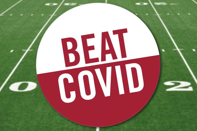 Beat COVID text over a football field.